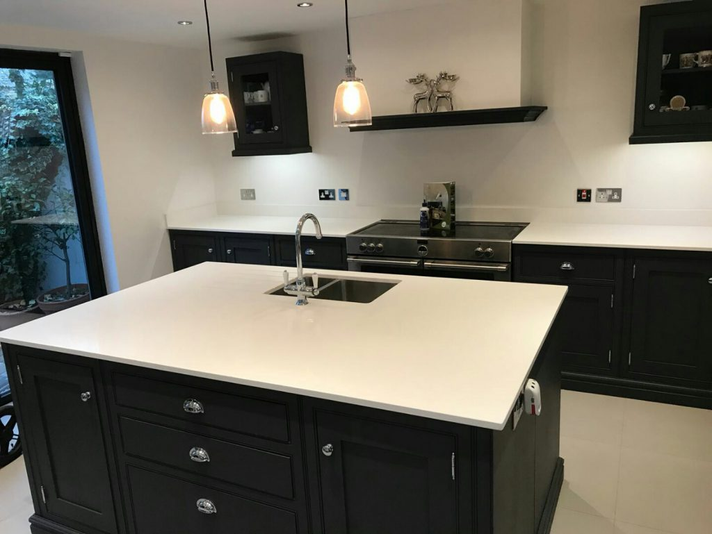 bianco puro white quartz worktops in traditional blue kitchen